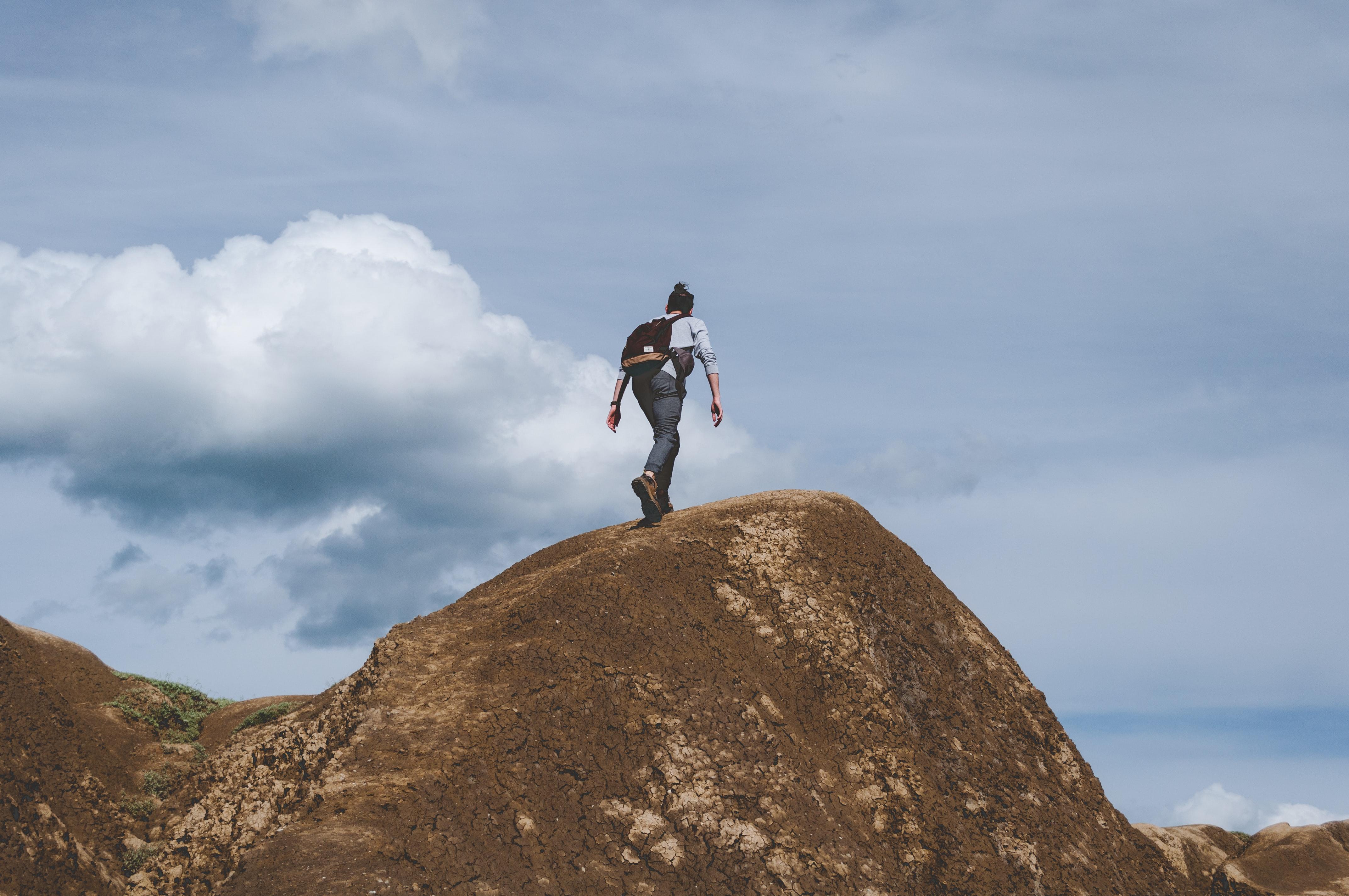 girl summiting mountain